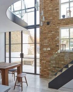 Exposed modern brick tiles feature wall landing